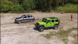 jeep bandit stock jeep vs porsche cayenne turbo hill climb rock crawling and