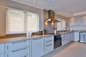 white wood venetian blinds installed by aesthetic shutters and