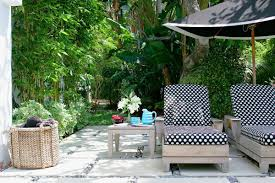 traditional outdoor design with chaise lounge cushions and black