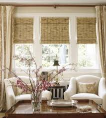 Hanging Curtains High Decor Roman Shades On The Living Room Windows In A Darker Color By
