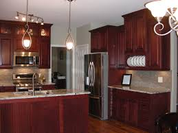 brown wooden cherry kitchen cabinet and kitchen island with marble