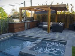 outdoor kitchen with pergola pool and interlocking toronto decks