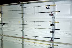 johnson garage doors fishing rod storage on garage door uses u bolts to hold rods and