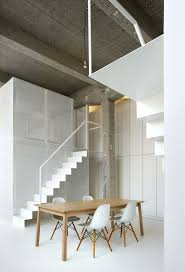 combination of wooden dining table added near an indoor stair land simple of lunch spwith wooden table along with clear chairs on glossy marble floor