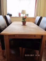 light oak solid wood extending dining table and 4 brown leather