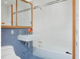 wall mounted bookshelves contemporary bathroom by zinc art interiors