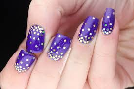 polish all the nails purple and gold hand placed glitter gradient