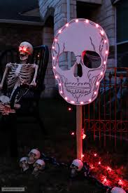 picture of a halloween skeleton how to make diy spooky skull yard signs for halloween
