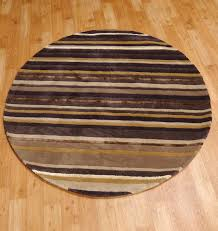 Modern Round Rugs by Art Stripe Circular Tonal Striped In Browns And Beiges