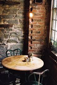 cafe dining area exposed brick intimate seating reclaimed