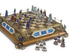 an austro hungarian silver gilt metal and enamel chess set and