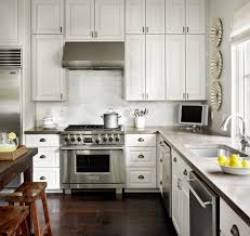 white kitchen cabinets with wood counters natural home design
