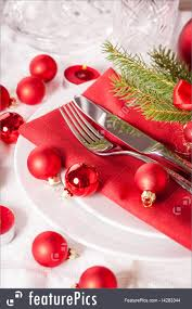 red themed christmas place setting image