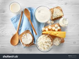 different types dairy products on wooden stock photo 573447319