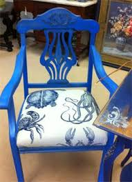 pretty vibrant blue chair painted with coastal colors