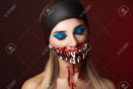 character with big teeth and black mouth professional make up