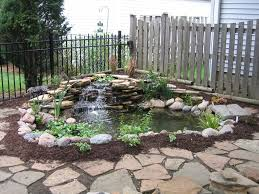 freshen bakyard small fish pond ideas with stone waterfall also