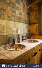 ceramic tile countertop inlaid hand painted copper sinks in main