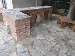 left over brick became the rustic outdoor kitchen area with a
