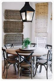 round country dining table baskets on wall lantern round table dining spaces pinterest