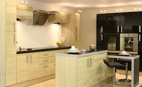 cream wooden cabinet and kitchen island with black counter top