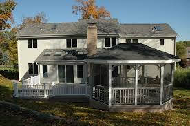 this screened gazebo and composite deck addition delivers double