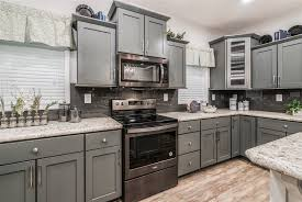 gray kitchen cabinets with black stainless steel appliances commodore homes of indiana aw462a oakley