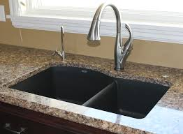 kitchen sink with faucet set the blanco silgranit kitchen sinks pair it with a delta