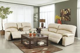 Reclining Sofa With Console by Signature Design By Ashley Damacio Cream Leather Match Glider