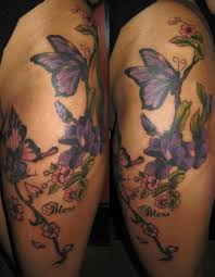flower butterfly tattoos purple flowers and butterfly thigh
