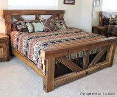 our custom made barn wood platform bed boasts a modern shape and