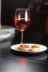 we like to cook and eat nye caprese bruschetta and a fizzy cocktail