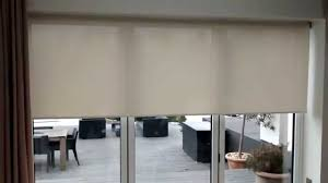 Glass Awnings For Doors Motorised Roller Blinds For Bi Fold Doors Premier Blinds