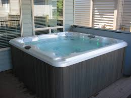 indoor or outdoor tub with cover that pulls back for the