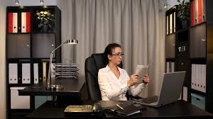 Dropbox Corporate Office Corporate Woman Reading Newspaper Financial Information