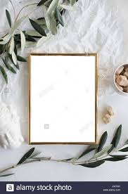 golden frame mock up on white tabletop background home decor