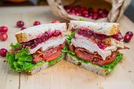 roast turkey club sandwich with cranberry sauce on closet cooking