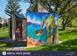 the colourful painted mural on the public toilets and changing stock photo the colourful painted mural on the public toilets and changing rooms at snells beach warkworth north island new zealand
