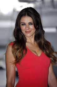 elizabeth hurley comes with damian for the royals uk premiere