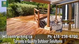 cedar deck with pergola and interlock basement walkout video
