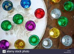 engraved serving tray of colourful moroccan tea glasses on engraved serving tray