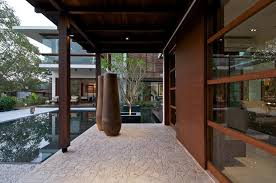 modern courtyard house architecture with reflection pool by hpa