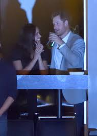prince harry and meghan markle canoodling at invictus games observer
