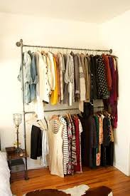 How To Make A Closet With Curtains Create Closet Space With A Tension Rod Maybe Hang Some Fabric To