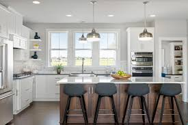 kitchen island colors with wood cabinets 4 kitchens with white cabinets and a wood island