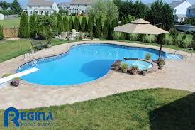 lagoon shaped vinyl liner swimming pool with diving board and