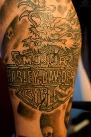 grey skull and harley davidson tattoo design on right half sleeve