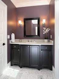 plum powder room w black cabinets add a cream colored