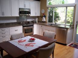 kraftmaid dove white kitchen cabinets kraftmaid lyndale dove white shaker cabinets and granite