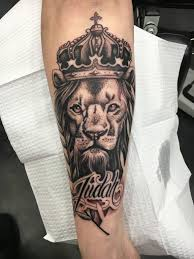 lion finger tattoos black ink crown on lion head tattoo on left arm